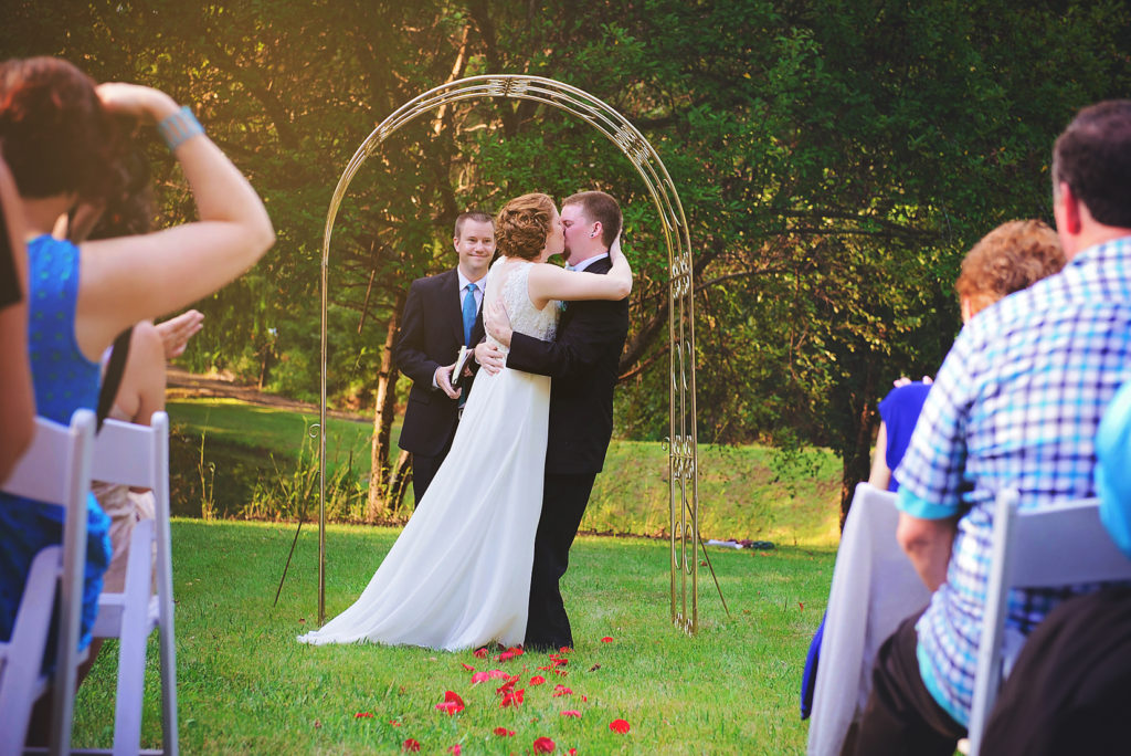 outdoor-wedding-ceremony-first-kiss